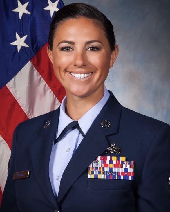 Lelah Windell in uniform with American flag in background