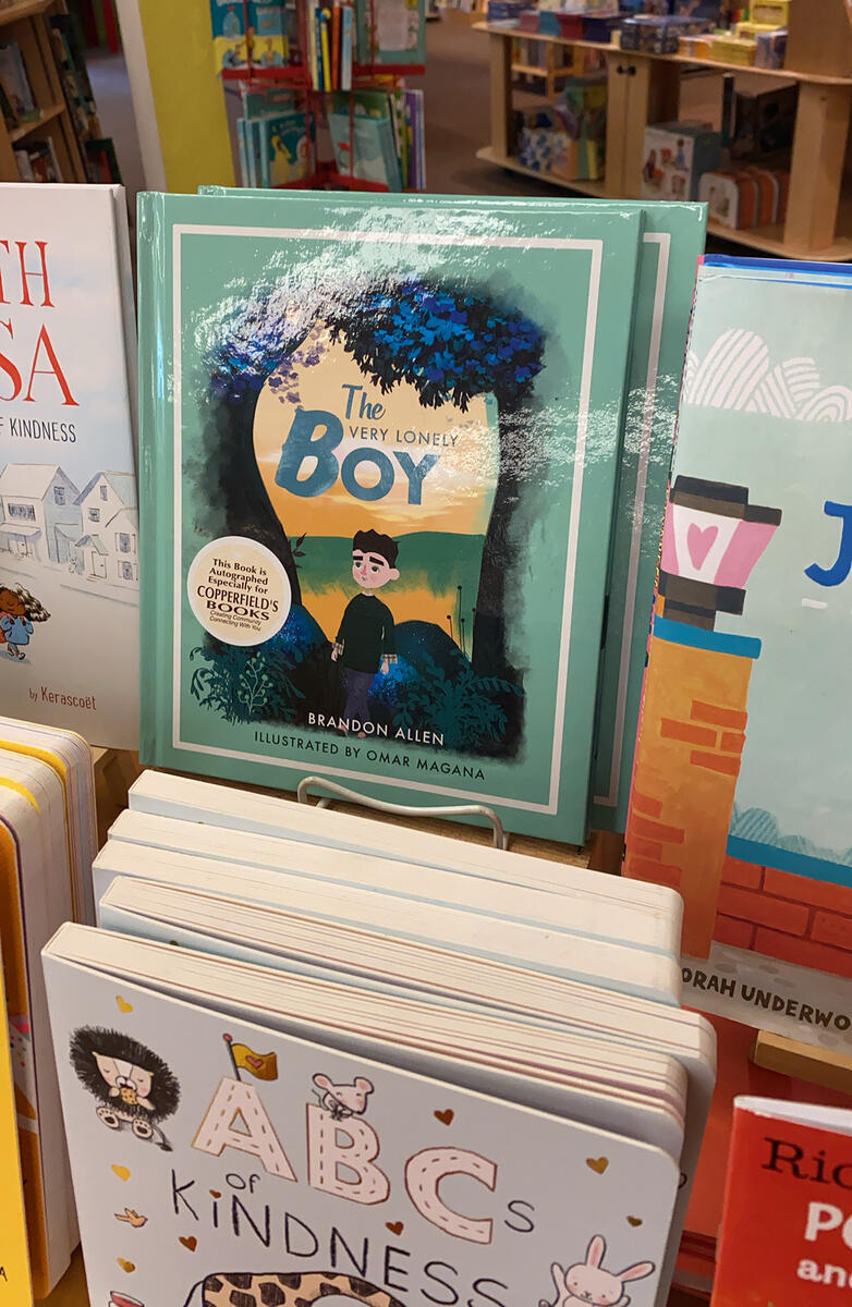 "Copies of ""The Very Lonely Boy"" on display in a bookstore"