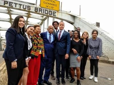 John Lewis with Barbara Lee and young activists on the Edmond Pettus Bridge